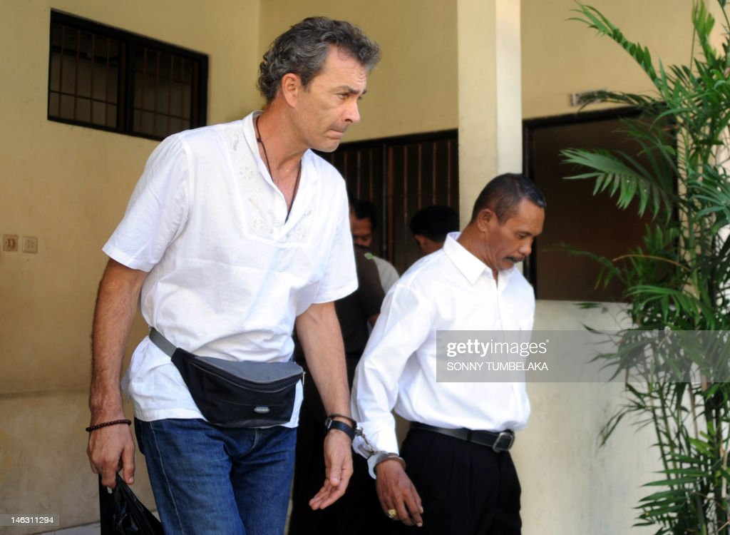 Edward Norman Myatt (L) of Australia walks from a holding cell after his trial at Denpasar court in Bali on June 14, 2012. Myatt, 54, was arrested on February 27 with 1.1 kg of hashish and 7 grams of methamphetamine after attempting to smuggle them into the Indonesian resort island of Bali.