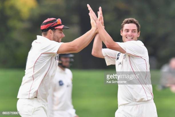 Edward Nuttall of Canterbury is congratulated by Tim Johnston of Canterbury after dismissing Luke Ronchi of Wellington during the Plunket Shield...