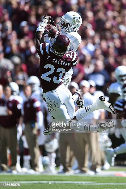 Edward Pope of the Texas AM Aggies catches a pass in front of Taveze Calhoun of the Mississippi State Bulldogs during the first quarter of a game at...