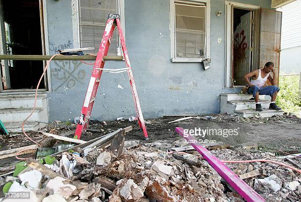Edward Robinson sits on the porch of his gutted home August 27 2006 in the Lower Ninth Ward of New Orleans Louisiana With the one year anniversary of...