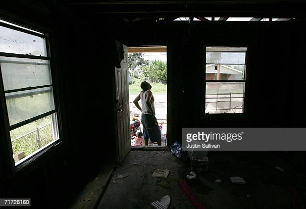Edward Robinson takes a break from doing construction on his gutted home August 27 2006 in the Lower Ninth Ward of New Orleans Louisiana With the one...
