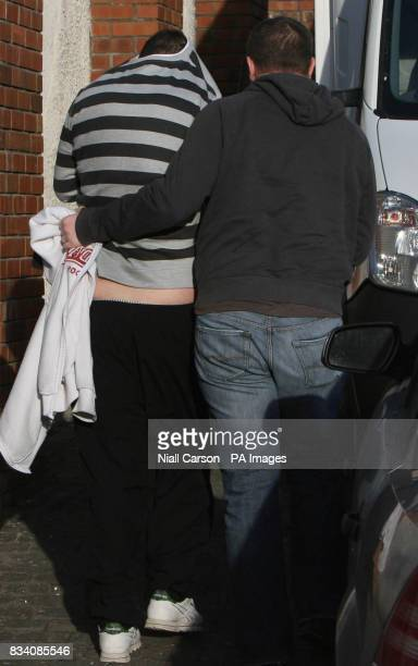 Edward Rooney covers his face as he arrives at Tallaght Court house in west Dublin to face charges in connection with a 2 million euro Heroin siezure...