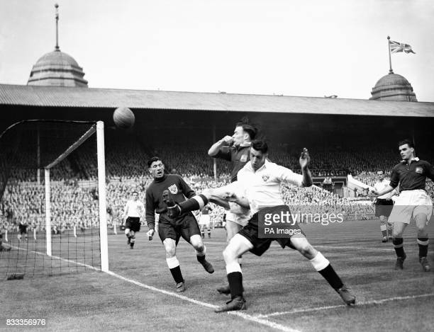 Edward Shimwell Blackpool right back and Charles Mitten Manchester United outside left tussle for the ball during a raid on the Blackpool goal in the...