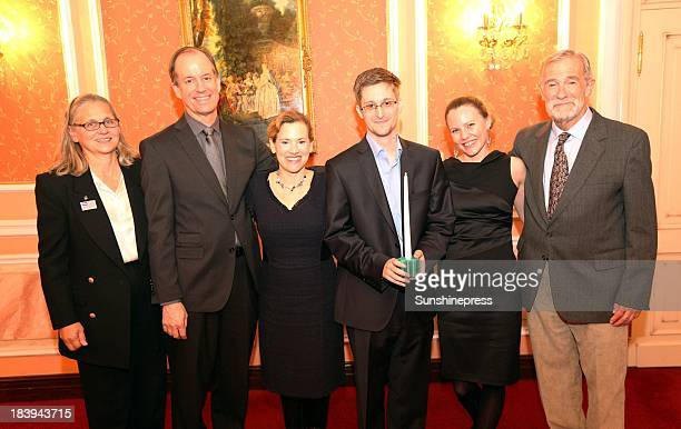 Edward Snowden receives the Sam Adams Associates for Integrity in Intelligence Award alongside UK WikiLeaks journalist Sarah Harrison who took...