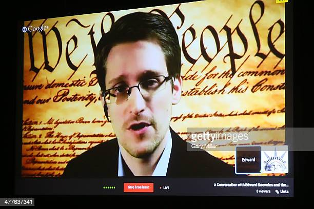 Edward Snowden speaks via satelite from an undisclosed location during the South By Southwest Interactive Festival at the Austin Convention Center on...
