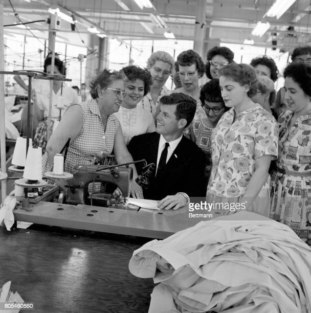 Edward 'Ted' Kennedy youngest brother of the President is surrounded by employees of the Foster Grant co in Leominster one of the many plants he...