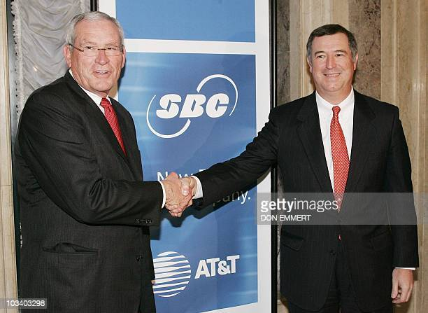 Edward Whitacre Jr CEO of SBC Communications and David Dorman Chairman and CEO of ATT shake hands 01 February 2005 before meetings in New York SBC...