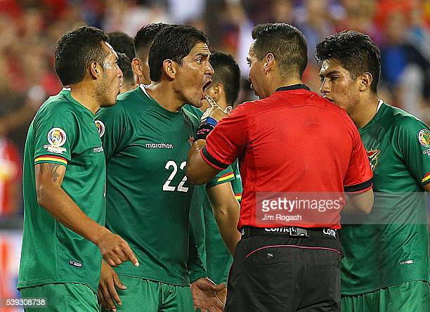 Edward Zenteno of Bolivia and Walter Veizaga argue with an official over a call against them that led to a game winning penaltykick goal by Chile...