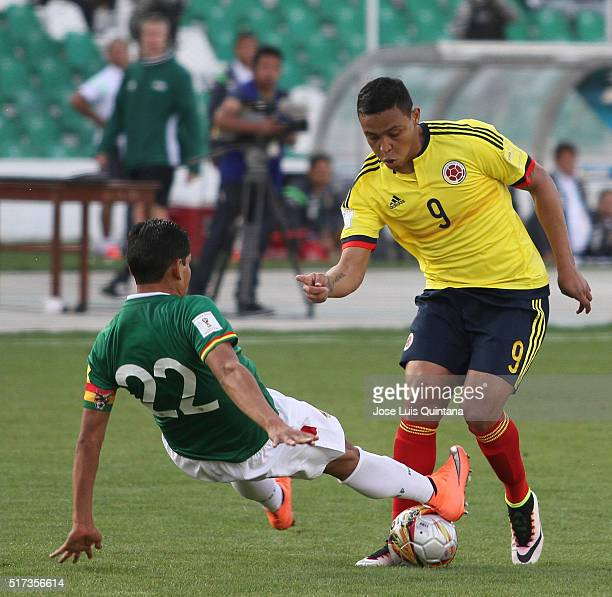 Edward Zenteno of Bolivia fights for the ball with Luis Muriel of Colombia during a match between Bolivia and Colombia as part of FIFA 2018 World Cup...