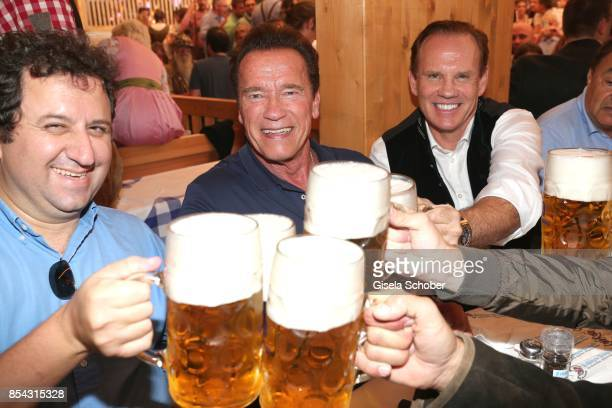 EdwardIsaac Dovere Arnold Schwarzenegger and Daniel Marshall attend the Oktoberfest at Schuetzen Festzelt at Theresienwiese on September 26 2017 in...