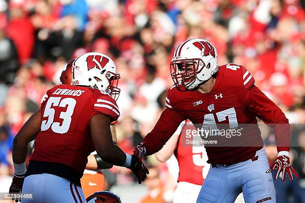 J Edwards and Vince Biegel of the Wisconsin Badgers celebrate a defensive stop during the first half of a game against the Illinois Fighting Illini...
