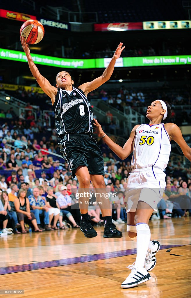 Edwige LawsonWade of the San Antonio Silver Stars shoots as Tangela Smith of the Phoenix Mercury defends on June 18 2010 at US Airways Center in...