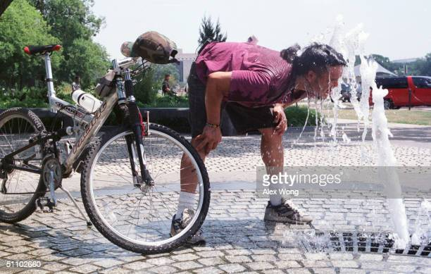 Edwin Balancuel Cools Himself Off At A Fountain In Washington Dc July 31 1999 This Has Been The Most Blistering July Since The National Weather...