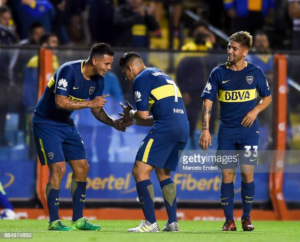 Edwin Cardona of Boca Juniors celebrates with Cristian Pavon after scoring the second goal of his team during a match between Boca Juniors and...
