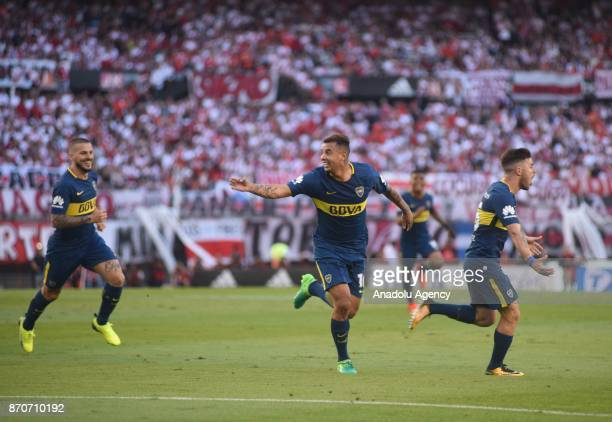 Edwin Cardona of Boca Juniors celebrates with Dario Bededetto Nahitan Nandez the first goal against River Plate during the match for the eighth date...