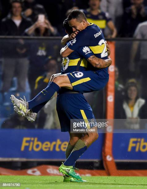 Edwin Cardona of Boca Juniors celebrates with his teammate Leonardo Jara after scoring the second goal of his team during a match between Boca...