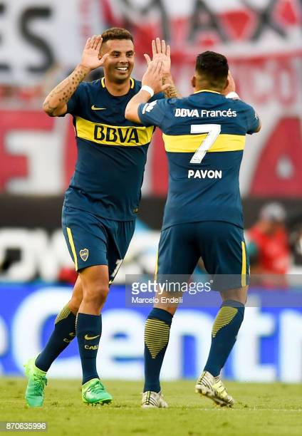 Edwin Cardona of Boca Juniors celebrates with teammate Cristian Pavon after scoring the first goal of his team during a match between River Plate and...
