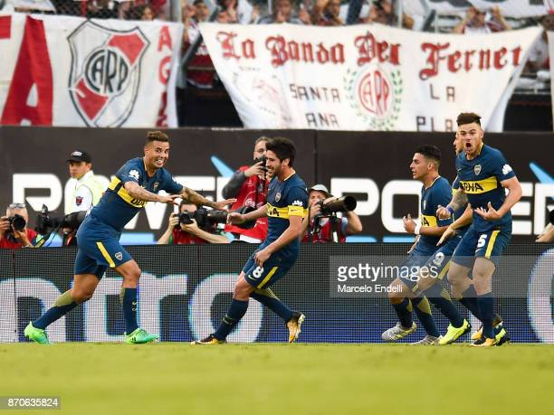 Edwin Cardona of Boca Juniors celebrates with teammates after scoring the first goal of his team during a match between River Plate and Boca Juniors...