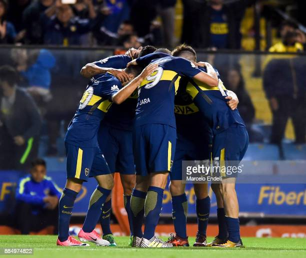 Edwin Cardona of Boca Juniors celebrates with teammates after scoring the second goal of his team during a match between Boca Juniors and Arsenal as...