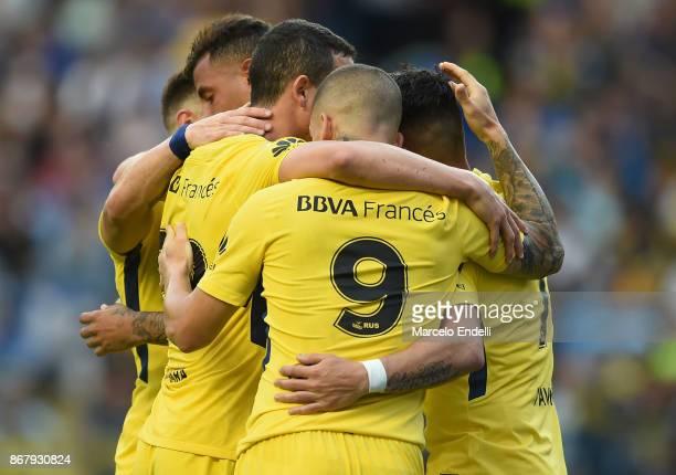 Edwin Cardona of Boca Juniors celebrates with teammates Dario Benedetto Cristian Pavon and Leonardo Jara after scoring the second goal of his team...
