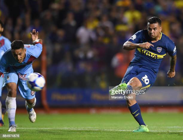 Edwin Cardona of Boca Juniors kicks the ball to score the second goal of his team during a match between Boca Juniors and Arsenal as part of the...