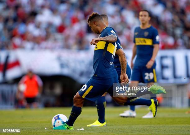 Edwin Cardona of Boca Juniors scores the opening goal during a match between River Plate and Boca Juniors as part of the Superliga 2017/18 at...