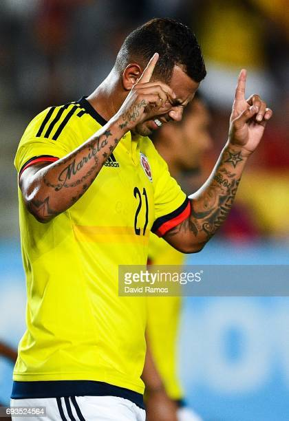 Edwin Cardona of Colombia celebrates after scoring his team's first goal during a friendly match between Spain and Colombia at La Nueva Condomina...