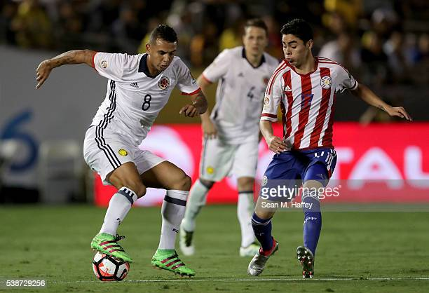 Edwin Cardona of Colombia dribbles around Miguel Almiron of Paraguay during the second half of a 2016 Copa America Centenario Group A match between...