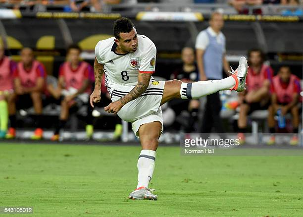 Edwin Cardona of Colombia follows through on a kick during a third place match between United States and Colombia at University of Phoenix Stadium as...