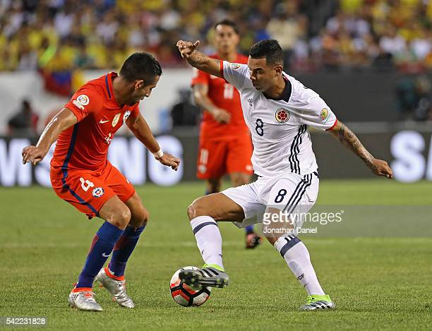 Edwin Cardona of Colombia moves against Mauricio Isla of Chile during a semifinal match in the 2016 Copa America Centernario at Soldier Field on June...