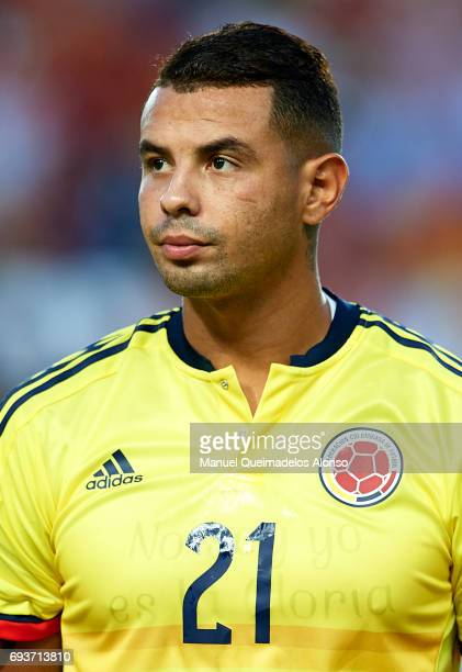 Edwin Cardona of Colombia stands for their national athem prior to the international friendly match between Spain and Colombia at Nueva Condomina...