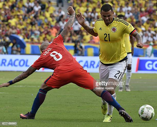 Edwin Cardona of Colombia struggles for the ball with Arturo Vidal of Chile during a match between Colombia and Chile as part of FIFA 2018 World Cup...