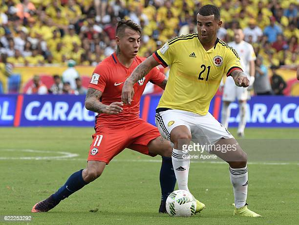 Edwin Cardona of Colombia struggles for the ball with Eduardo Vargas of Chile during a match between Colombia and Chile as part of FIFA 2018 World...