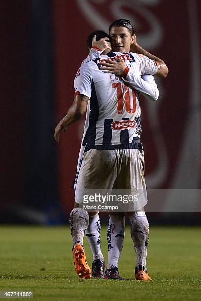 Edwin Cardona of Monterrey celebrates with his teammate Hiram Mier after scoring his team's second goal during a match between Monterrey and Leon as...