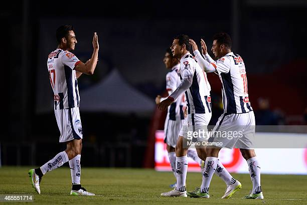Edwin Cardona of Monterrey celebrates with teammates after scoring his team's first goal during a match between Monterrey and Toluca as part of 9th...