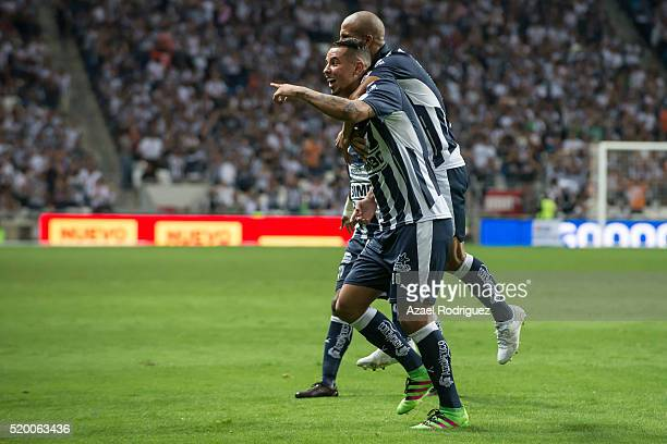 Edwin Cardona of Monterrey celebrates with teammates after scoring his team's third goal during the 13th round match between Monterrey and Chiapas as...