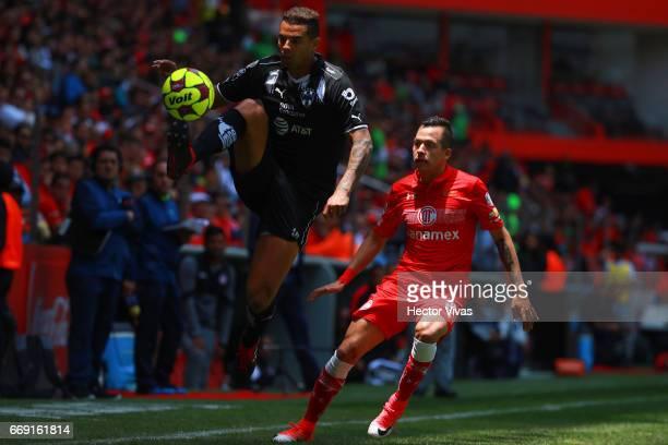 Edwin Cardona of Monterrey controls the ball under pressure of Rodrigo Salinas of Toluca during the 14th round match between Toluca and Monterrey as...