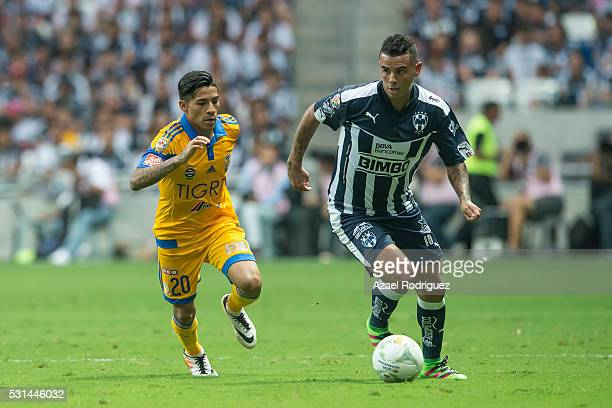 Edwin Cardona of Monterrey fights for the ball with Javier Aquino of Tigres during the quarter finals second leg match between Monterrey and Tigres...