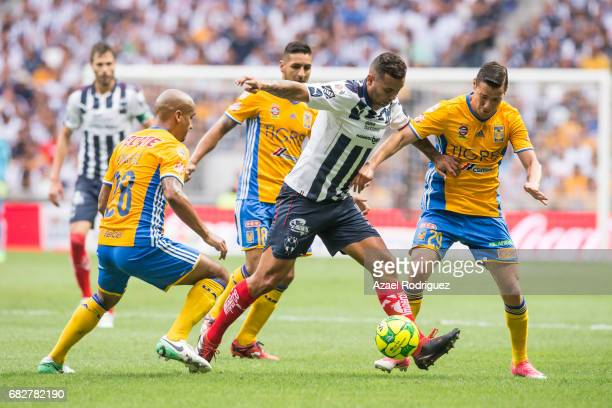 Edwin Cardona of Monterrey fights for the ball with Luis Rodriguez Ismael Sosa and Jesus Duenas of Tigres during the quarter finals second leg match...