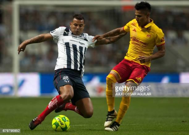 Edwin Cardona of Monterrey vies for the ball with Raúl Ruidiaz of Morelia during their Mexican Clausura 2017 tournament football match at the BBVA...