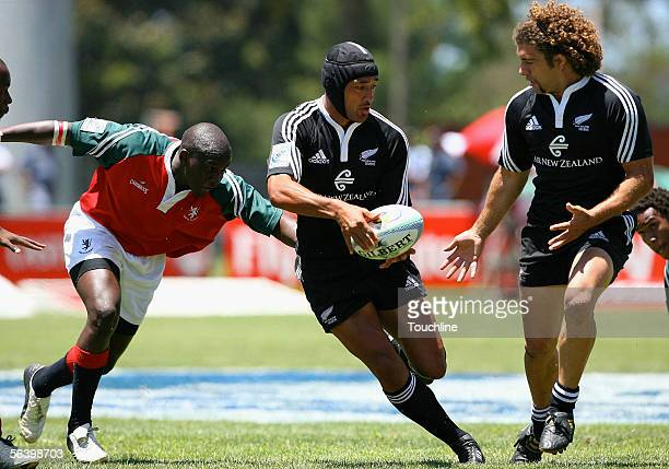 Edwin Cocker of New Zealand passes to Matua Parkinson during the IRB Sevens Series match between New Zealand and Kenya at the George Rugby Ground on...