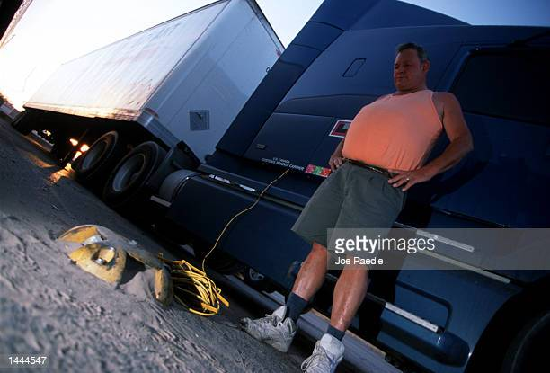 Edwin Duke who has been trucking for 15 years checks his cable TV and modem connection May 29 2000 to the Park and View post at the Petro truck stop...