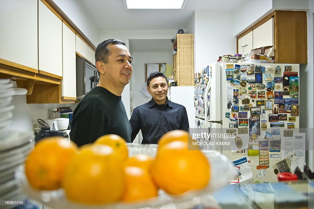COURONNE 'USA-POLITIQUE-IMMIGRATION-HOMOSEXUALITE-MARIAGE' Edwin Echegoyen (L) and Rodrigo Martinez chat in the kitchen in their home in Rockville, Maryland, on February 26, 2013. Edwin, a 46-year-old naturalized US citizen from El Salvador, and Rodrigo Martinez, 34, an illegal resident from El Salvador, who have been together for ten years and got married in Washington, DC, in 2011 but for the Federal government, which does not recognize marriage between same-sex couples, they may as well just be housemates. Rodrigo is counting on US President Barack Obama's push for immigration reform to finally be able to become a legal resident. AFP PHOTO/Nicholas KAMM
