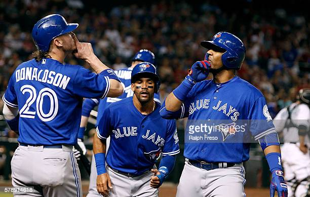 Edwin Encarnacion and Josh Donaldson of the Toronto Blue Jays gesture in celebration of Encarnacion's threerun home run against the Arizona...