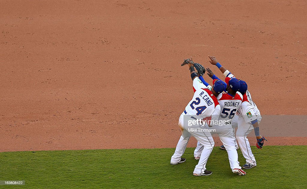 Edwin Encarnacion #10, Fernando Rodney #56 and Robinson Cano #24 of the Dominican Republic celebrate after winning a World Baseball Classic second round game against Puerto Rico at Marlins Park on March 16, 2013 in Miami, Florida.