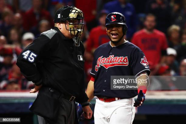 Edwin Encarnacion of the Cleveland Indians agrues a third strike call by umpire Jeff Nelson in the fourth inning against the New York Yankees in Game...