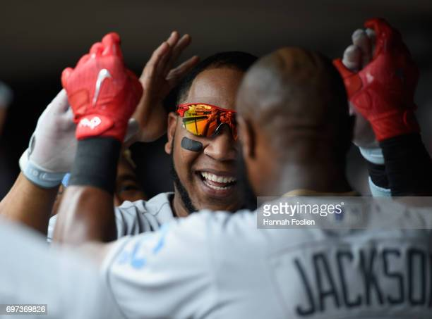 Edwin Encarnacion of the Cleveland Indians celebrates a tworun home run against the Minnesota Twins during the sixth inning of the game on June 18...