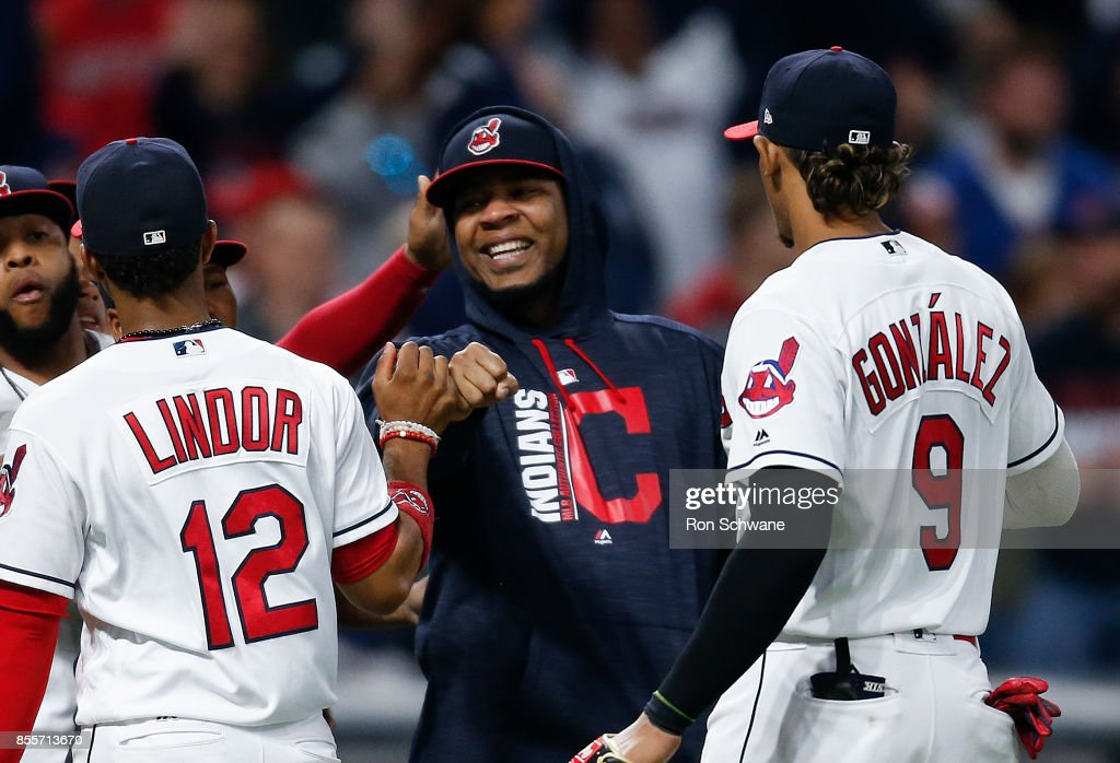 Edwin Encarnacion #10 of the Cleveland Indians celebrates with Francisco Lindor #12 and Erik Gonzalez #9 after defeating the Chicago White Sox 10-1 at Progressive Field on September 29, 2017 in Cleveland, Ohio.