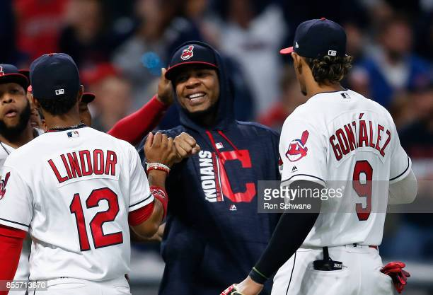 Edwin Encarnacion of the Cleveland Indians celebrates with Francisco Lindor and Erik Gonzalez after defeating the Chicago White Sox 101 at...