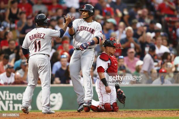 Edwin Encarnacion of the Cleveland Indians celebrates with Jose Ramirez after hitting a two run home run against the Boston Red Sox during the fifth...